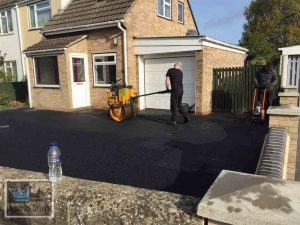 Tarmac Driveway Being Hand Rolled After Machine Rolling
